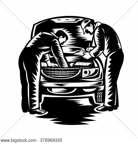 Retro Woodcut Style Illustration Of Two Automotive Mechanic Doing Vehicle Car Service And Repair Vie
