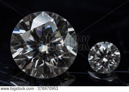 Big And Small Carat Diamond On Black Background