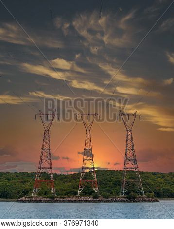 Three Power Pylons On The Saint Lawrence Seaway In Quebec, Canada