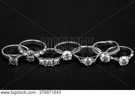 Precious Jewelry Rings On The Black Background