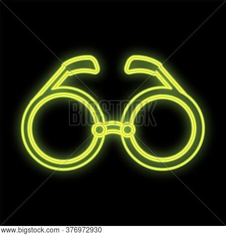 Yellow Bright Neon Glasses On A Black Background. Fashionable, Stylish, Sunglasses With Spf Factor.