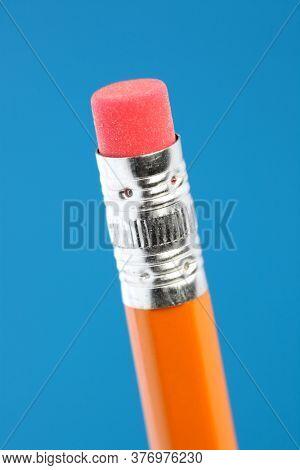 Close up of single yellow pencil eraser