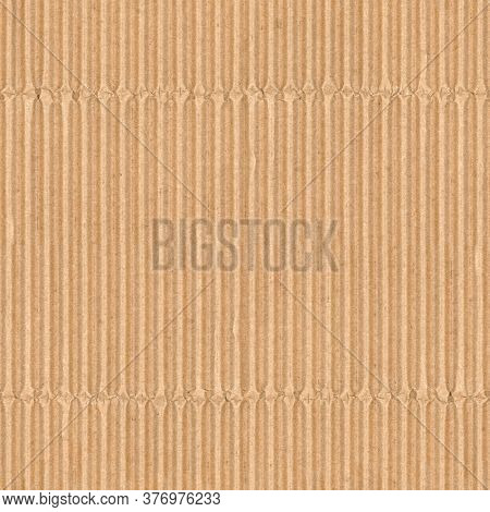 Corrugated cardboard texture. Blank empty cardboard with ridges and folded creases. Recycled material background. Seamless tiled texture.