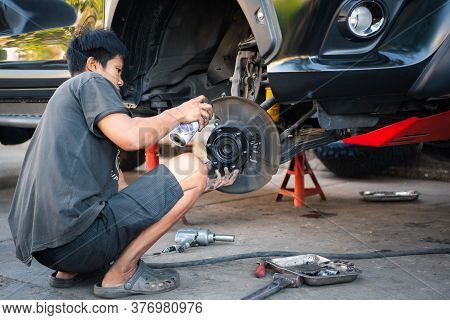 Bangkok, Thailand - February 15, 2020 : Unidentified Car Mechanic Or Serviceman Disassembly And Chec