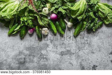 Fresh Organic Vegetables And Greens Background. Cucumbers, Lettuce, Tarragon, Red Onion, Garlic, Rom
