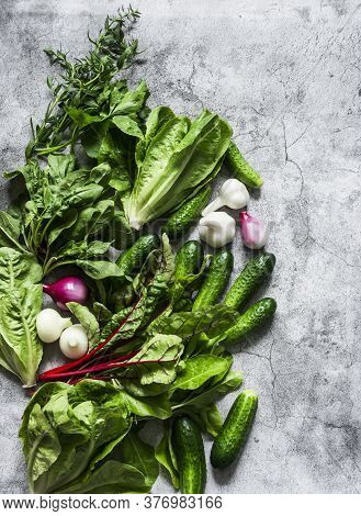 Fresh Vegetables And Herbs Background. Cucumbers, Romaine Lettuce, Chard, Coriander, Red Onion, Garl
