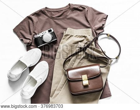 Women Clothing. Brown T-shirt, Cotton Joggers Jeans, White Sneakers, Leather Cross Body Bag And Came