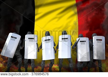 Belgium Protest Stopping Concept, Police Squad In Heavy Smoke And Fire Protecting Peaceful People Ag