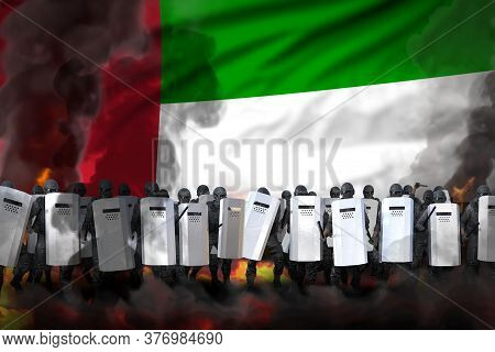 United Arab Emirates Police Officers In Heavy Smoke And Fire Protecting State Against Riot - Protest