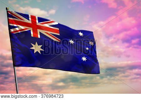 Fluttering Australia Flag On Colorful Cloudy Sky Background. Australia Prospering Concept.