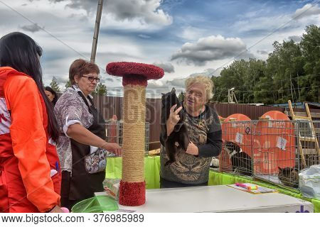Russia, Sertolovo, Leningrad Region, 13,08,2016: : Unidentified Member Of The Exhibition Shows His C