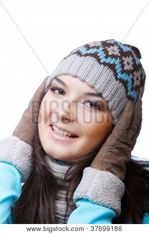 woman in cap and winter gloves