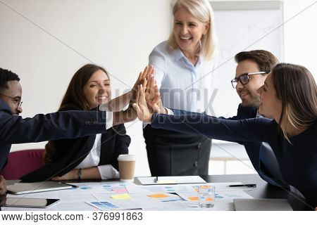 Diverse Businesspeople Giving High Five Attending At Teambuilding Activity