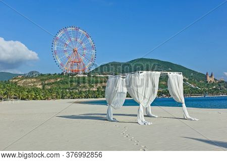 Summer, Beach, Sea. On The White Sand Stands An Awning With Translucent White Curtains. Palm Trees I