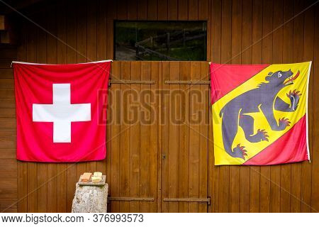 Wengen, Bernese Oberland, Switzerland - July 31 2019 : Swiss Flag And Flag Of Canton Bern On A Woode