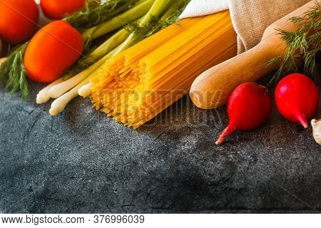 Vegetables On A Concrete Background. Tomatoes, Cucumbers, Peppers, Radishes, Garlic, Onions, Herbs O
