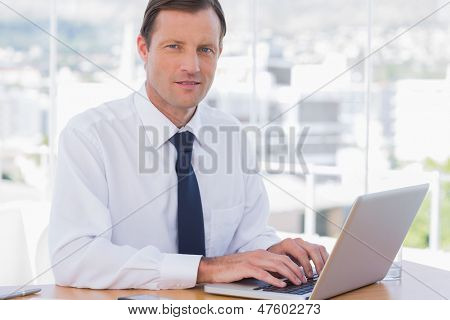 Businessman working with his laptop in his office