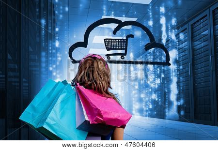 Woman in a data center holding shopping bags and looking at a drawing with a shopping cart into a cloud