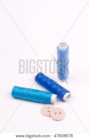 thread of spool and needle