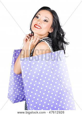 Young Chinese Woman Walking With Shopping Bags