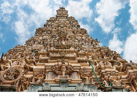 Facade of the big traditional tower (gopuram) of Hindu temple Matale Sri Muttu Mariyamman Sri Lanka poster