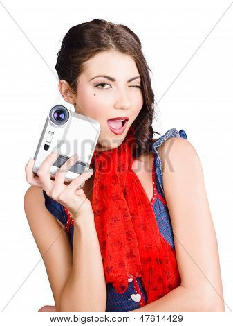 Woman Holding A Home Video Camera. Making Movies