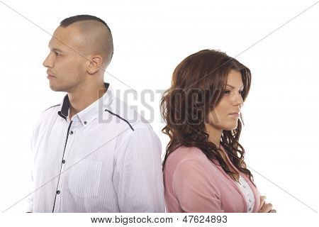 Unhappy Couple Standing Back To Back Over White Background