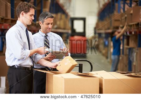 Businessmen Checking Boxes With Digital Tablet And Scanner