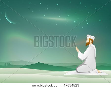 Muslim young mans in traditional dress praying (Namaz, Islamic Prayer) in shiny moonlight night background.