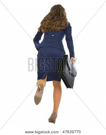 Full Length Portrait Of Running Business Woman With Briefcase .