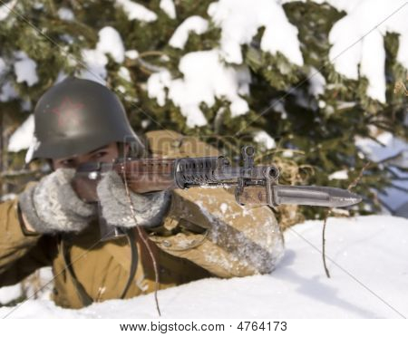 Soviet-finnish War 1939-1940: Red Army Soldier Aims From A Rifle. Focus On A Rifle
