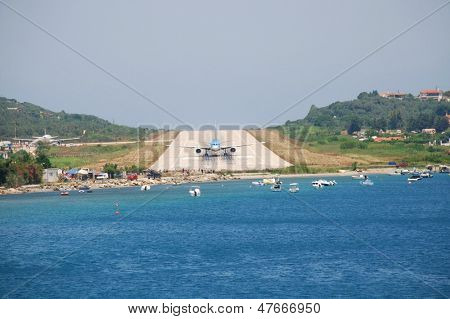 SKIATHOS, GREECE - JUNE 14: A plane on the runway at Alexandros Papadiamantis airport on June 14, 2013 on the Greek island of Skiathos. At 5341 foot, the runway is amongst the shortest in Europe.