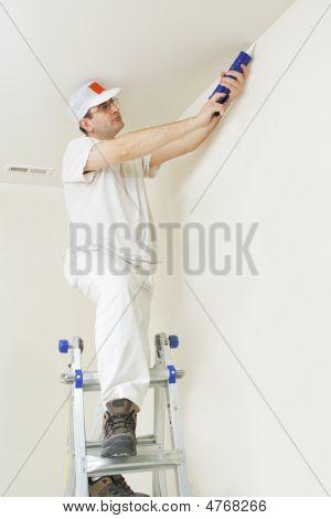 Painter Repairing Cracks