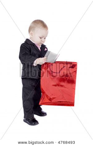 Happy Kid With His Present Over A White Background