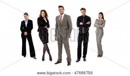 Full-length formal team portrait of businesspeople standing in line looking at camera, smiling. Isolated on white.
