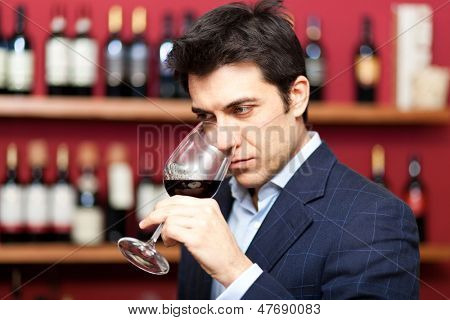 Sommelier analyzing a glass of red wine