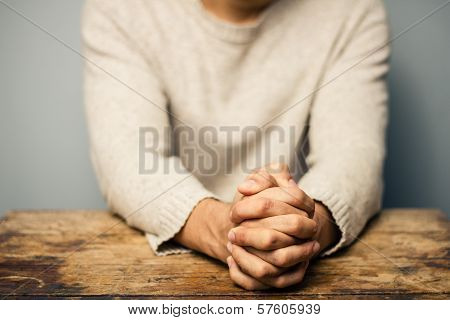 Praying Man At Desk