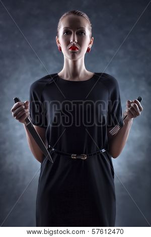 Woman With Knife And Fork.