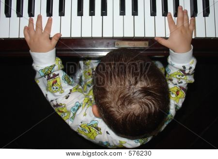 Infant Playing The Piano