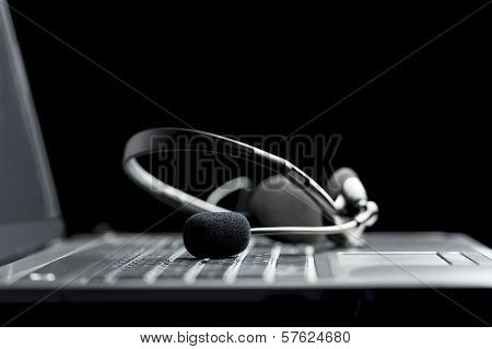 Headset Lying On A Laptop Computer