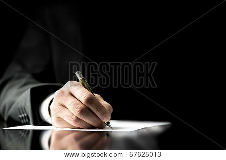 Businessman signing a document taking notes completing a questionnaire or writing correspondence close up view of his hand and the paper poster