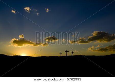 Sunrise or sunset on three empty Roman crosses