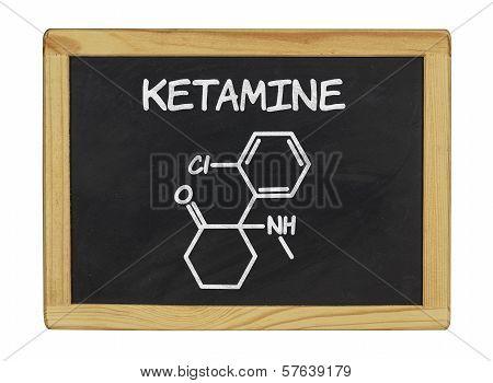 chemical formula of ketamine on a blackboard