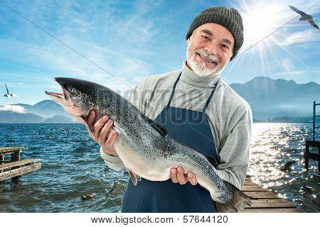 Fisherman Holding A Big Atlantic Salmon