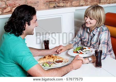 Couple Enjoying Dinner At A Restaurant