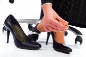 Wearing high heel shoes has its painful disadvantages - hurting feet sole. poster