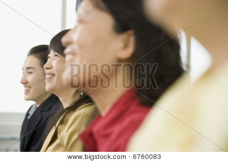 Side View Of Four Women Of Varying Ages