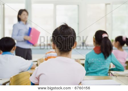 Classroom Of Students Watching Teacher