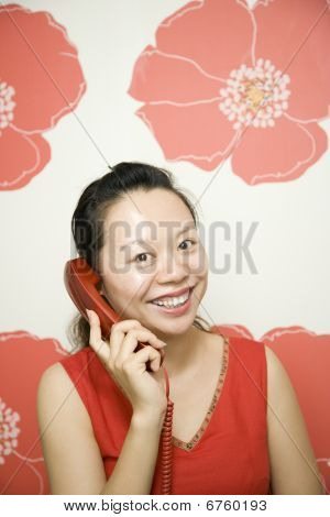 Young Woman With Phone By Red Poppy Background