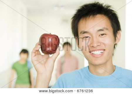 Young Asian Guy With Apple